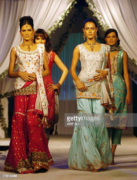 Pakistani models showcase creations during a fashion show in Lahore late 31 October 2007 Some 14 designers participated in the fashion show organized...