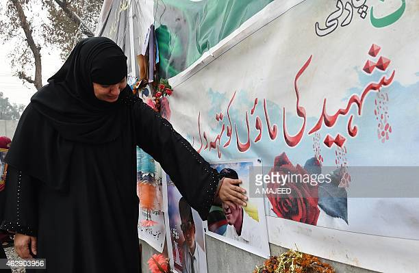 A Pakistani mother of a schoolchild killed in a Taliban attack on the Army Public School reacts during a protest against delays in the investigation...