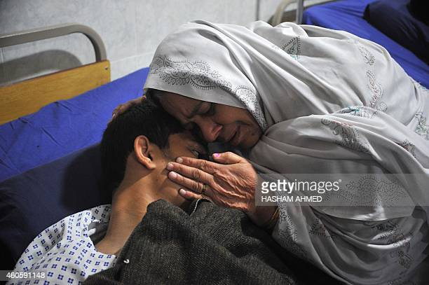 A Pakistani mother reacts with her injured son a day after an attack on an armyrun school by Taliban militants in Peshawar on December 17 2014...