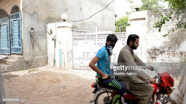 Pakistani motorcyclist drives past the native house of Khuram Shazad Butt one of the three attackers of the London terror attack in his hometown in...