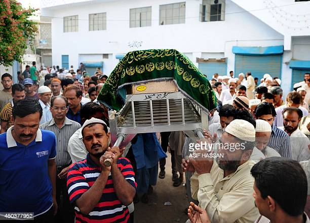 Pakistani mourners arrive for funeral prayers for a victim of an assault by militants at Karachi's Jinnah International Airport in Karachi on June 10...
