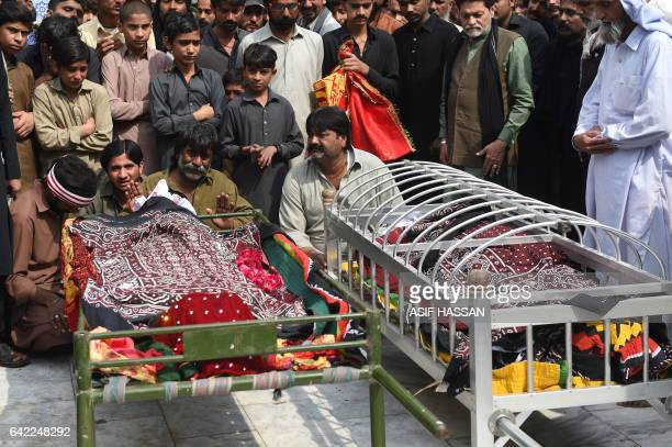 Pakistani mourners attend the funeral prayers for the blast victims in the town of Sehwan in Sindh province some 200 kilometres northeast of the...