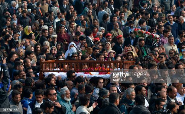 TOPSHOT Pakistani mourners carry the coffin of lawyer and rights advocate Asma Jahangir during her funeral in Lahore on February 13 2018 Pakistan bid...