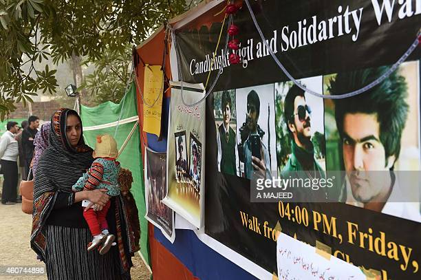 Pakistani mourners gather outside the armyrun school where 149 people were massacred by the Taliban in Peshawar on December 21 2014 Thousands of...