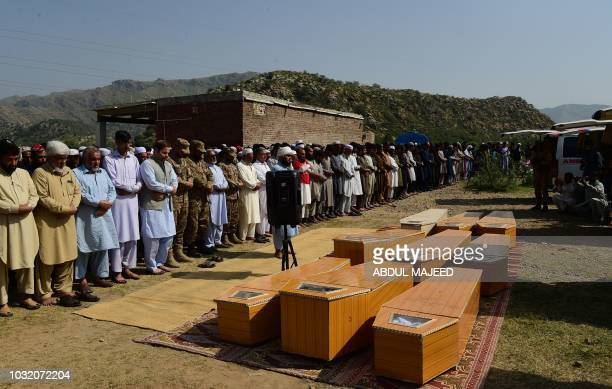 Pakistani mourners offer funeral prayers for the miners killed in a collapsed coal mine accident in Darra Adam Khel town on September 12 2018 Nine...