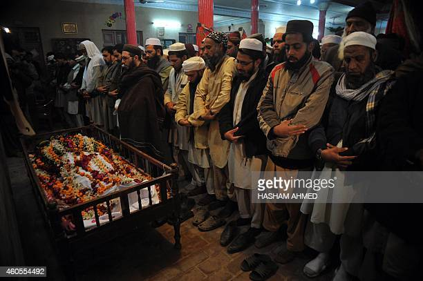 Pakistani mourners pray during the funeral of a student following an attack by Taliban gunmen on a school in Peshawar on December 16 2014 Taliban...