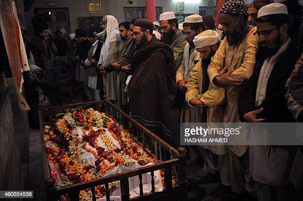 Pakistani mourners pray during the funeral of a victim following an attack by Taliban gunmen on a school in Peshawar on December 16 2014 Taliban...
