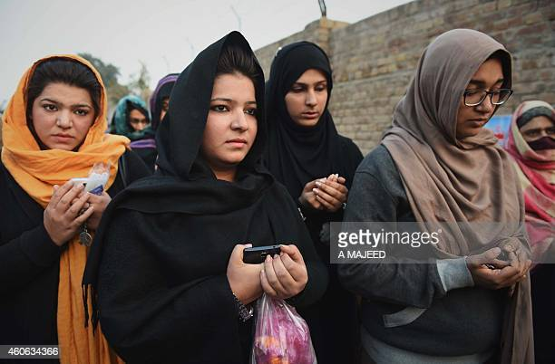 Pakistani mourners pray for the children and teachers killed in an attack by Taliban militants outside the armyrun school where the attack took place...