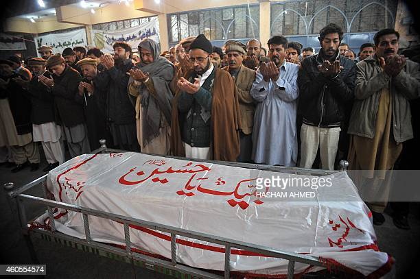 Pakistani mourners pray over the coffin of a student following an attack by Taliban gunmen on a school in Peshawar on December 16 2014 Taliban...