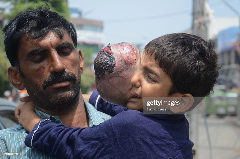 Pakistani Muhammad Mansha resident of a village Ghaus Nagar district Pak Pattan Punjab's provincial along with 7 year old son Ali Hassan who is...