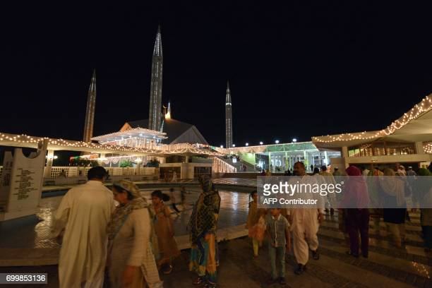 Pakistani Muslim arrive to offer evening prayers on Lailat alQader also known as the Night of Power the 27th night of the Holy month of Ramadan on...