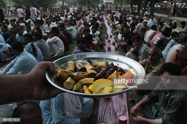 Pakistani Muslim carries the iftar food before breaking their fast during the holy month Ramadan in Lahore Pakistan on July 1 2014