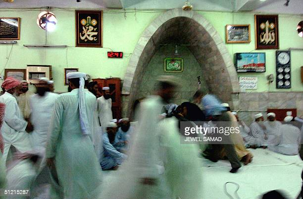 Pakistani Muslim clerics gather inside the Lal Mashjid one of the oldest mosques prior to a meeting 25 August 2004 Pakistani Islamist leaders and...