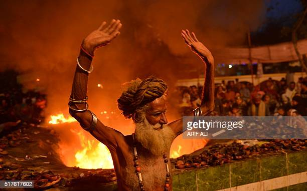 A Pakistani Muslim devotee dances around a fire at the shrine of Sufi saint Hazrat Shah Hussain popularly known as Madhu Lal Hussain during annual...