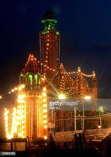 Pakistani Muslim devotees arrive at a illuminated mosque to pray during the EideMiladunNabi the birthday of Prophet Mohammad celebrations in Lahore...