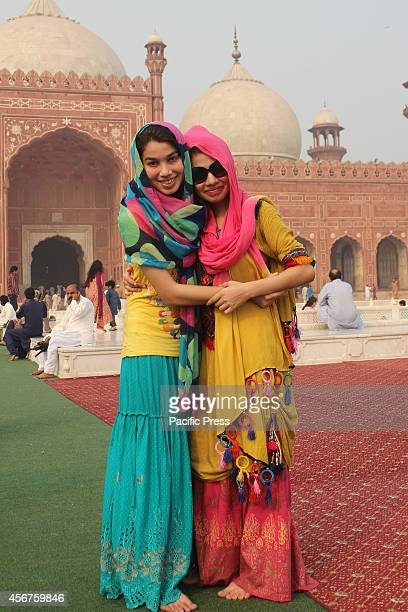 Pakistani Muslim devotees hug each other after the Congregational prayers of Eid alAdha in Lahore Muslims around the world celebrate the Eid alAdha...
