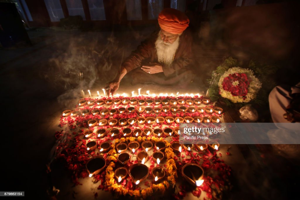 Pakistani Muslim devotees light candles and earthen lamps at the shrine of famous fifteenth century Sufi Saint Hazrat Mir Mohammed Muayyinul during...