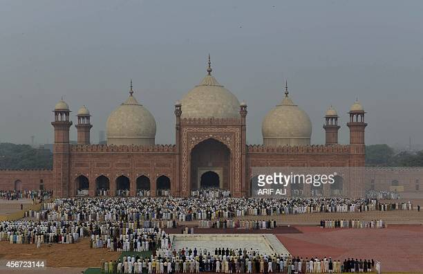 Pakistani Muslim devotees offer Eid alAdha prayers at the Badshahi Mosque in Lahore on October 6 2014 Muslims across the world are celebrating the...