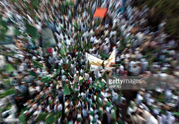 Pakistani Muslim devotees wave green flags as they take part in a march to celebrate EideMiladunNabi the birthday of Prophet Mohammad in Lahore 22...