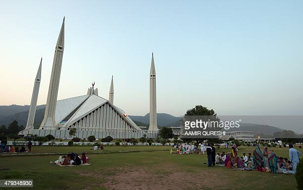 Pakistani Muslim families gather beside the grand Faisal Mosque to break their Ramadan fast in Islamabad on July 3 2015 Ramadan is marked by Muslims...