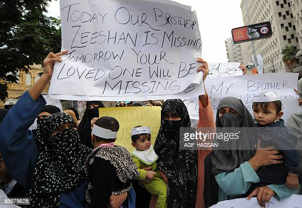Pakistani Muslim families of missing person hold placards during a protest in Karachi on December 7 2008 ahead of the Muslim festival of Eid alAdha...