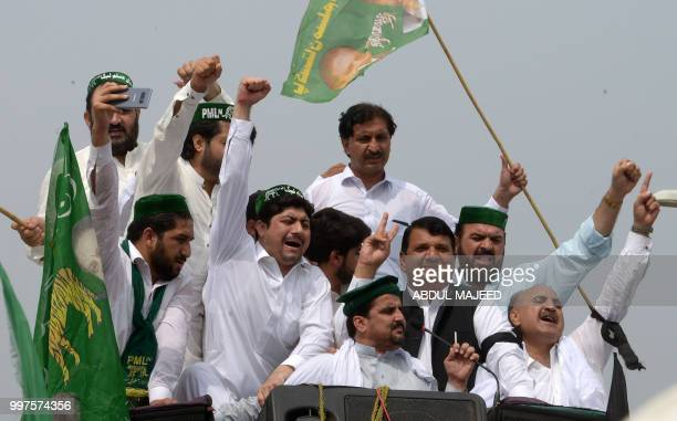 Pakistani Muslim LeagueNawaz activists shout slogans as they start a journey towards Lahore to welcome former prime minister Nawaz Sharif on his...