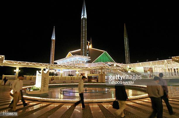 Pakistani Muslim men arrive at the Faisal Mosque in Islamabad 09 October 2007 on the occasion of the Laylat AlQadr Festival Laylat alQadr is the...
