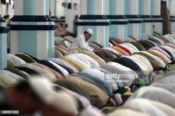 Pakistani Muslim offer evening prayers at a mosque in Karachi on June 22 2017 on Lailat alQader also known as the Night of Power and the 27th night...