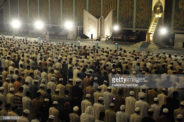 Pakistani Muslim pray at the Faisal Mosque in Islamabad on September 6 2010 on the ShabeQadr the 27th night of the Holy month of Ramadan in which...