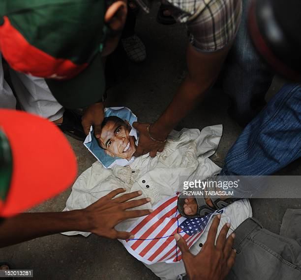 Pakistani Muslim protesters beat an effigy of the US President Barack Obama during a rally against an antiIslam movie in Karachi on September 15 2012...