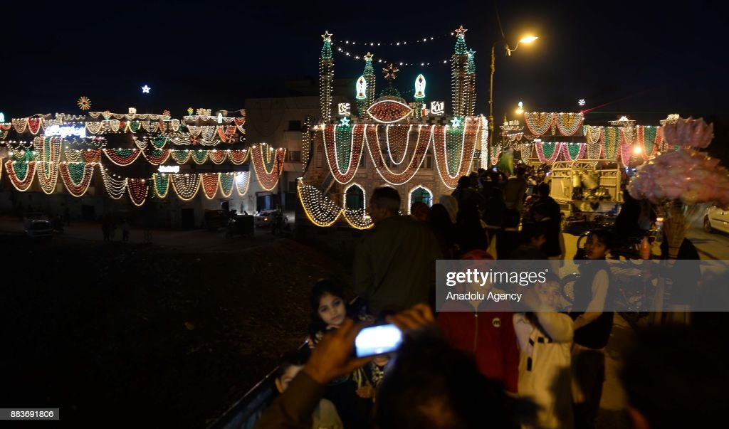 Pakistani Muslim takes selfie with illuminated buildings during the celebrations for Mawlid alNabi the birth anniversary of Muslims` beloved Prophet..