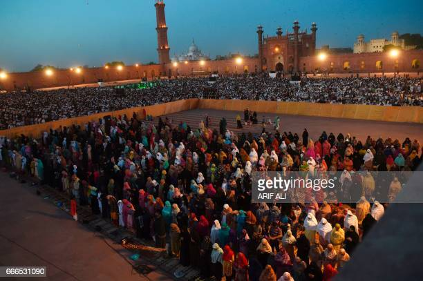 Pakistani Muslim women are segregated from the men as they offer prayers led by Saudi Arabian Imam of the Grand Mosque in Mecca Sheikh Saleh Mohammad...