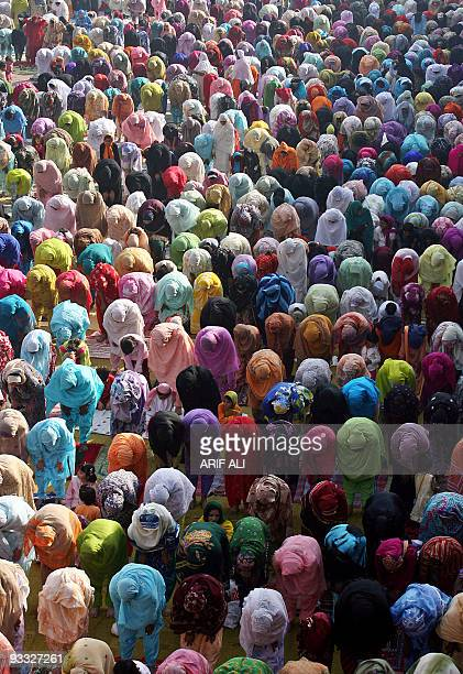 Pakistani Muslim women offer Eid prayers at the historical Badshahi Mosque during the first day of the Eid alFitr religious festival in Lahore 14...