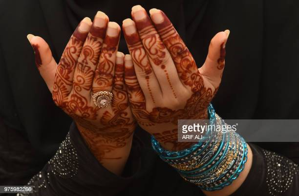 A Pakistani Muslim worshipper prays to mark Eid alFitr at the Badshahi Mosque in Lahore on June 16 2018 Muslims around the world are celebrating the...