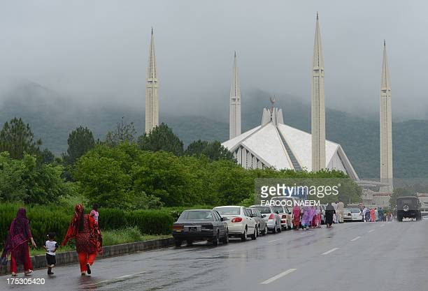 Pakistani Muslims arrive at The Faisal Mosque in Islamabad on August 2 for the JummatUlVida prayers The threeday Muslim Eid festival which begins...