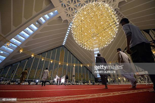 Pakistani Muslims arrive to perform a special 'Taraweeh' evening prayer on the first day of the Muslim fasting month of Ramadan at the grand Faisal...