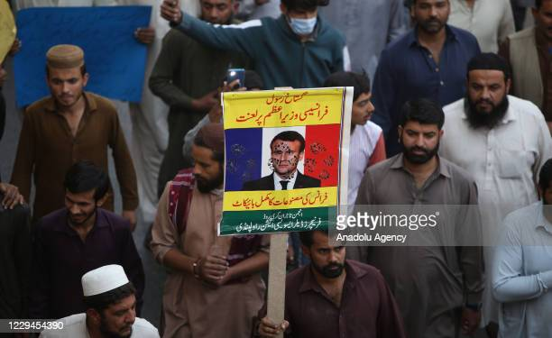 Pakistani Muslims banners as they take part in a demonstration against the republication of offensive caricatures of the Prophet Muhammad in France...