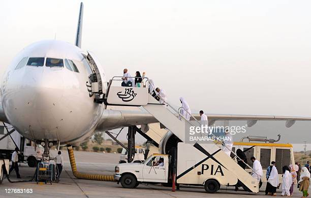 Pakistani Muslims board a Pakistan International Airlines aircraft to Mecca in Saudi Arabia for the annual Hajj pilgrimage from Quetta International...