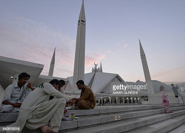 Pakistani Muslims break their fast at Faisal Mosque in Islamabad on June 17 2016 during the holy fasting month of Ramadan Muslims throughout the...