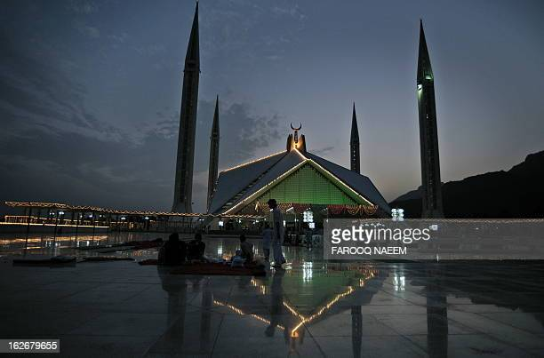 Pakistani Muslims break their fast at the Faisal Mosque in Islamabad on September 6 on the last week of Holy month of Ramadan Muslims around the...