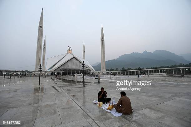 Pakistani muslims break their fast during the holy fasting month of Ramadan at Faisal Mosque in Islamabad Pakistan on June 26 2016