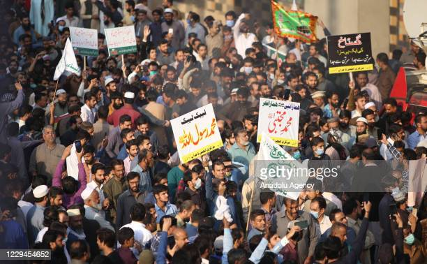 Pakistani Muslims carry flags and banners as they take part in a demonstration against the republication of offensive caricatures of the Prophet...