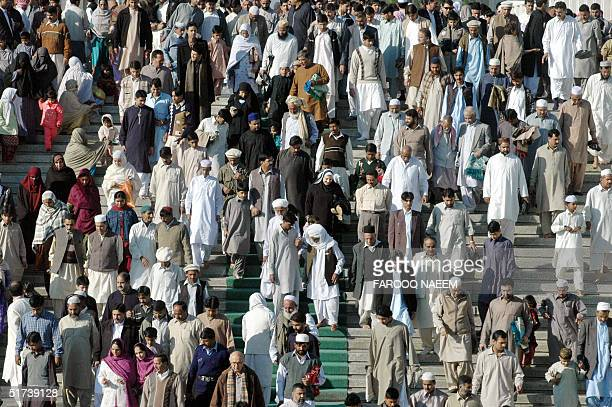 Pakistani Muslims leave the Faisal Mosque after giving Eid alFitr prayers in Islamabad 14 November 2004 Millions of Pakistani offered prayers in...
