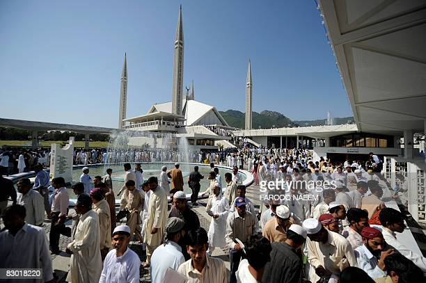 Pakistani Muslims leave the Faisal Mosque after offering the JummatulVida prayers during the last week of the Muslim month of Ramadan in Islamabad on...