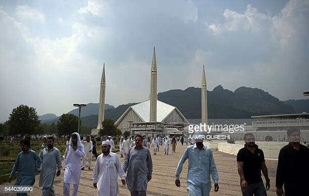 Pakistani Muslims leave the grand Faisal Mosque after offering JummatulVida the last congregational Friday prayers in the holy month of Ramadan at a...
