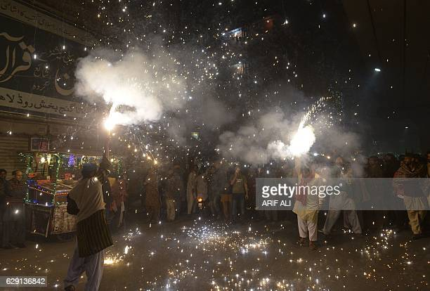 Pakistani Muslims light fireworks during celebrations on Mawlid alNabi the birth anniversary of Prophet Mohammed in Lahore on December 11 2016 Birth...