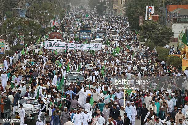 Pakistani Muslims march in a rally during celebrations commemorating the birth of Muslims' beloved Prophet Muhammed known in Arabic as Mawlid alNabi...
