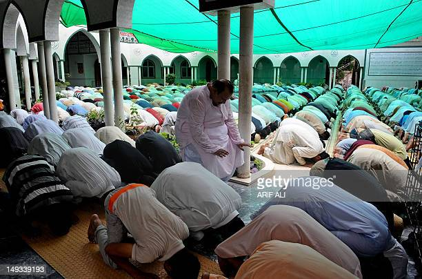 Pakistani Muslims offer congregational prayers during the first Friday of Ramadan in Lahore on July 27 2012 During Ramadan eating drinking sex and...