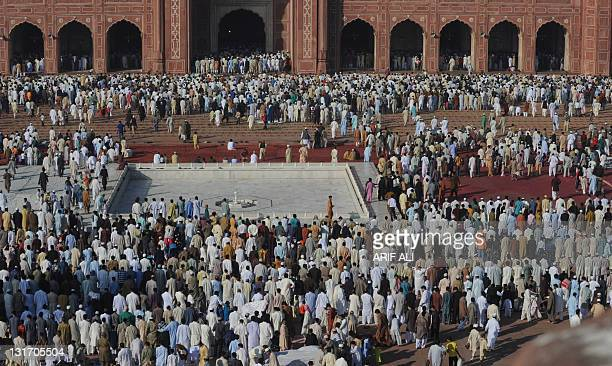 Pakistani Muslims offer Eid prayers at the Badshahi Mosque in Lahore on November 7 2011 Islam's second biggest annual festival Eid alAdha is...