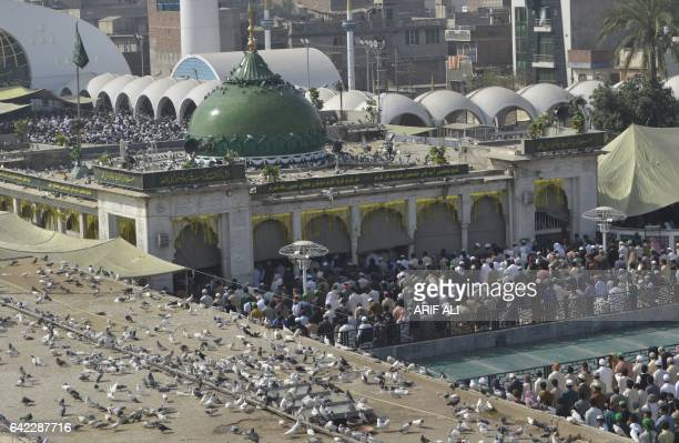 Pakistani Muslims offer Friday prayers at the shrine of Saint Syed Ali bin Osman AlHajvery popularly known as Data Ganj Bakhsh in Lahore on February...